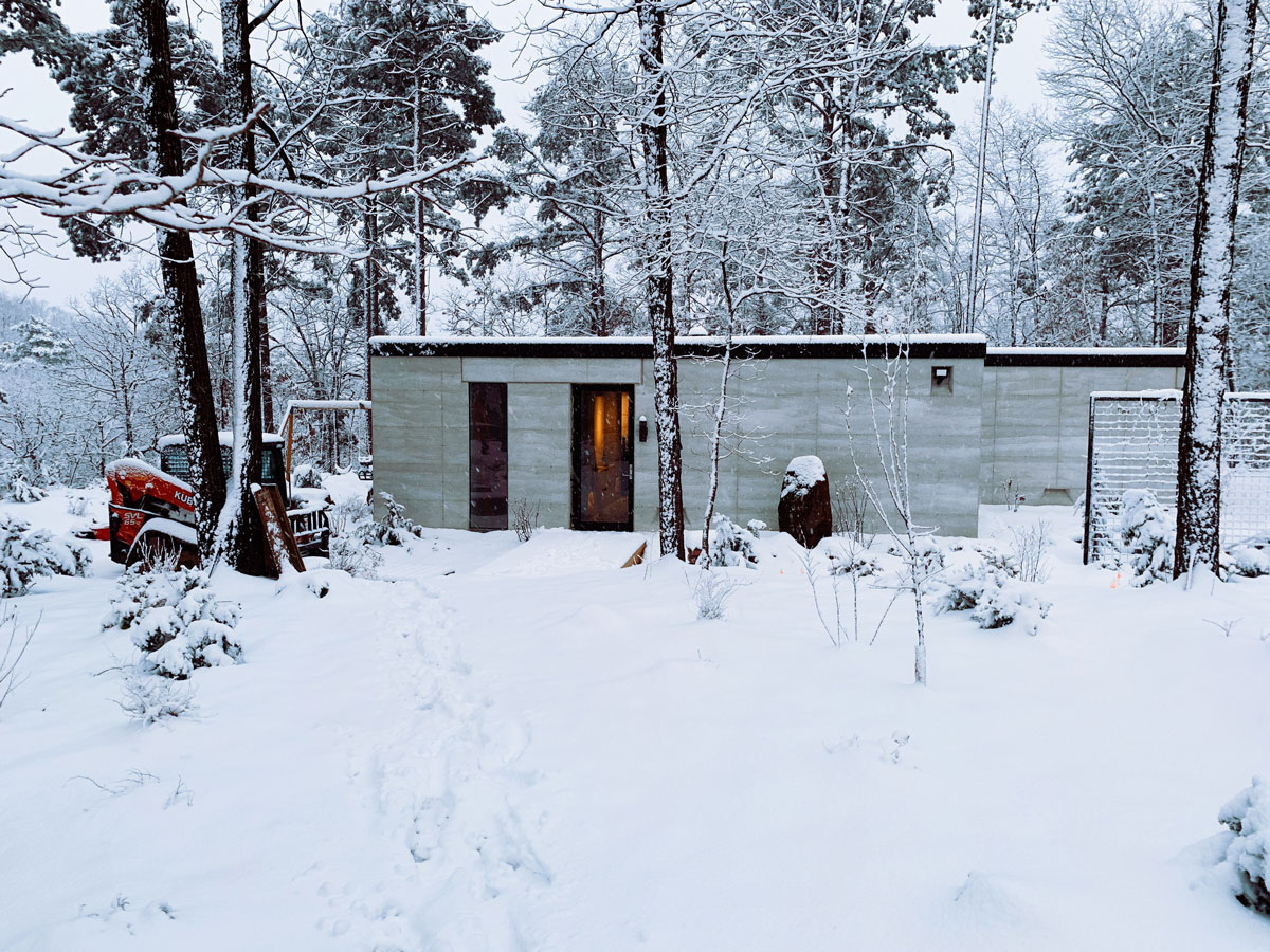 The snow was falling heavy at the rammed earth cabin in the woods in NW Arkansas