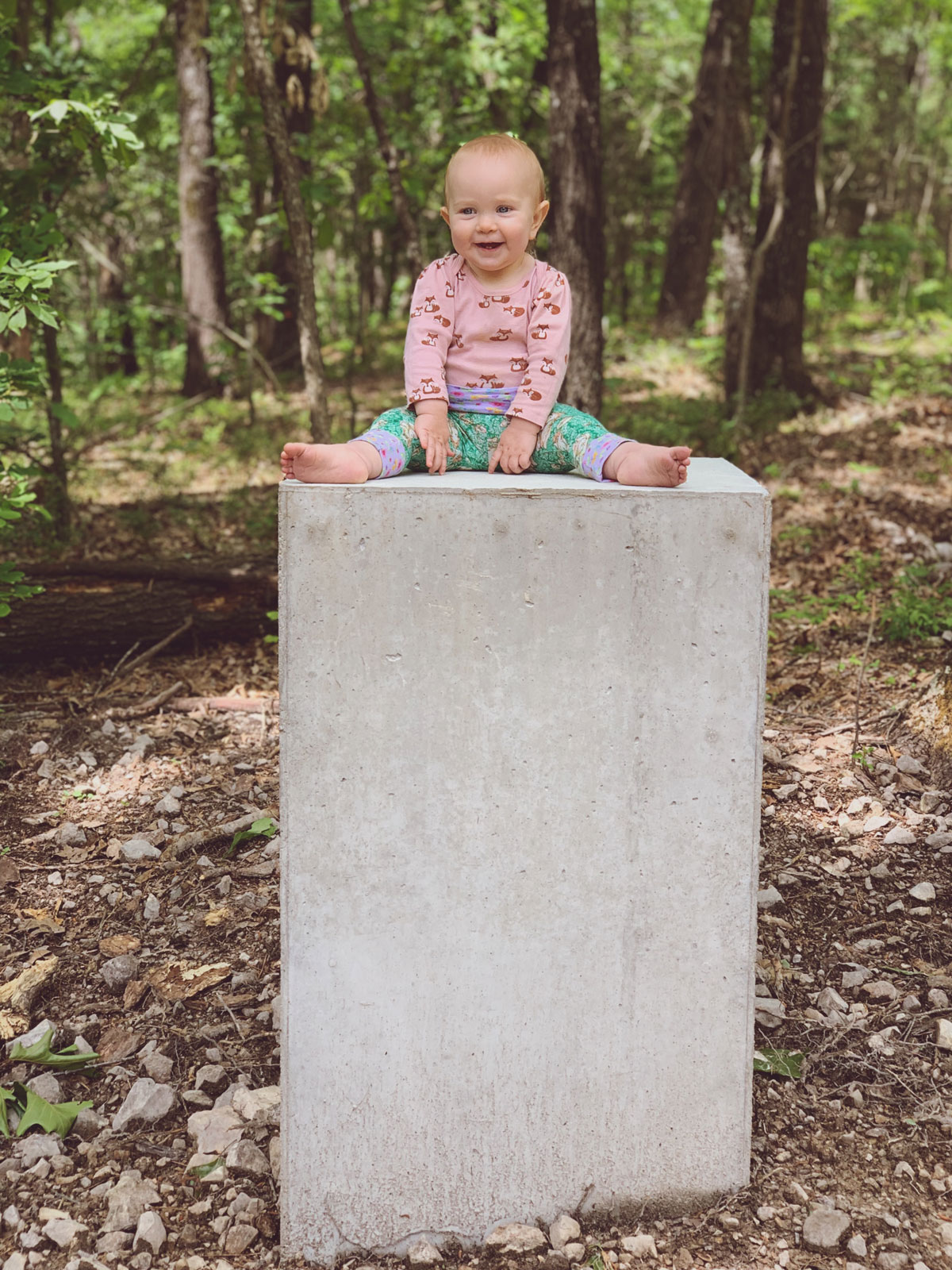 Brandon Gore's beautiful daughter sitting on a concrete art plinth - perhaps the most perfect artwork?