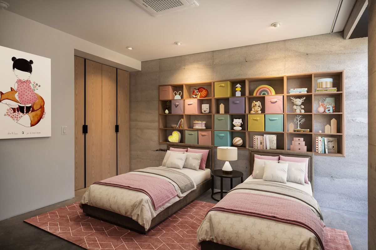 A modern kids room for two girls features a recessed oak bookcase in the rammed earth wall