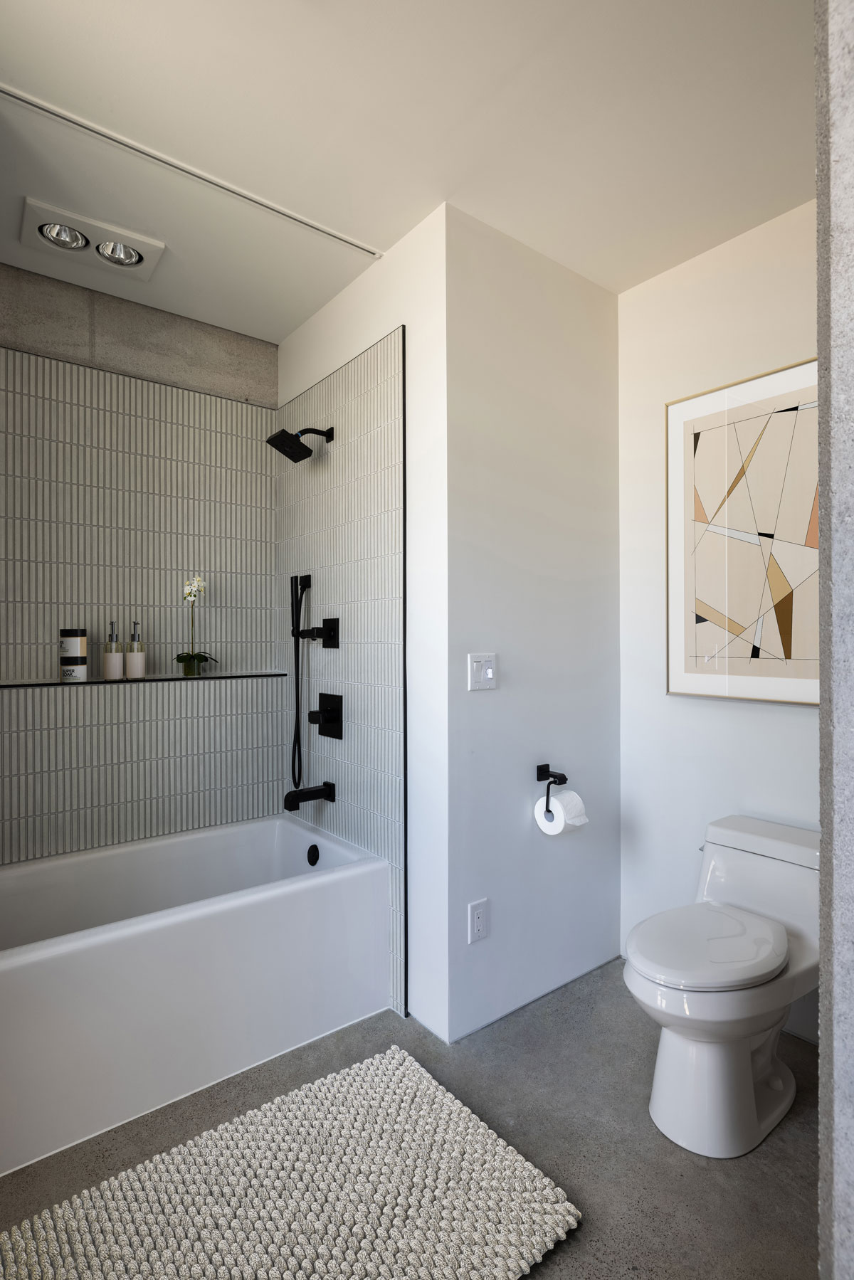 A clean and simple contemporary bathroom in a NW Arkansas custom modern home.