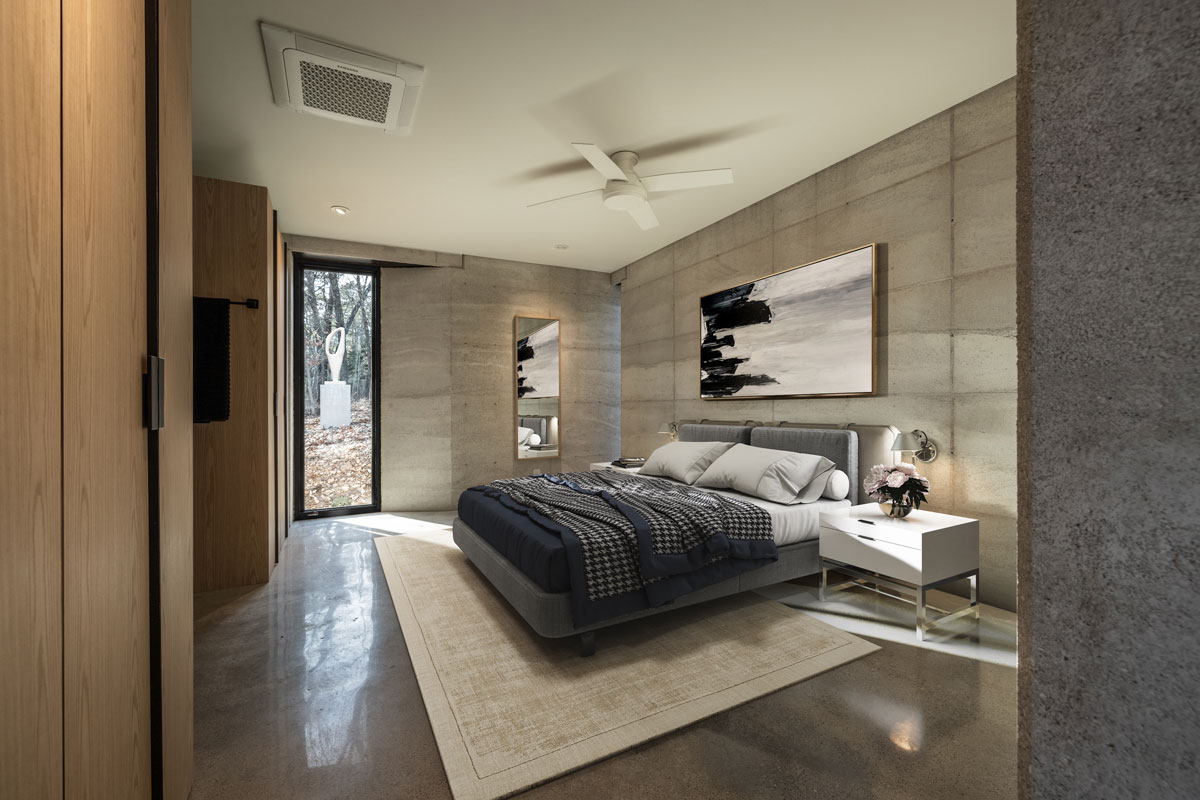 A modern yet warm master bedroom in this rammed earth cabin in the United States