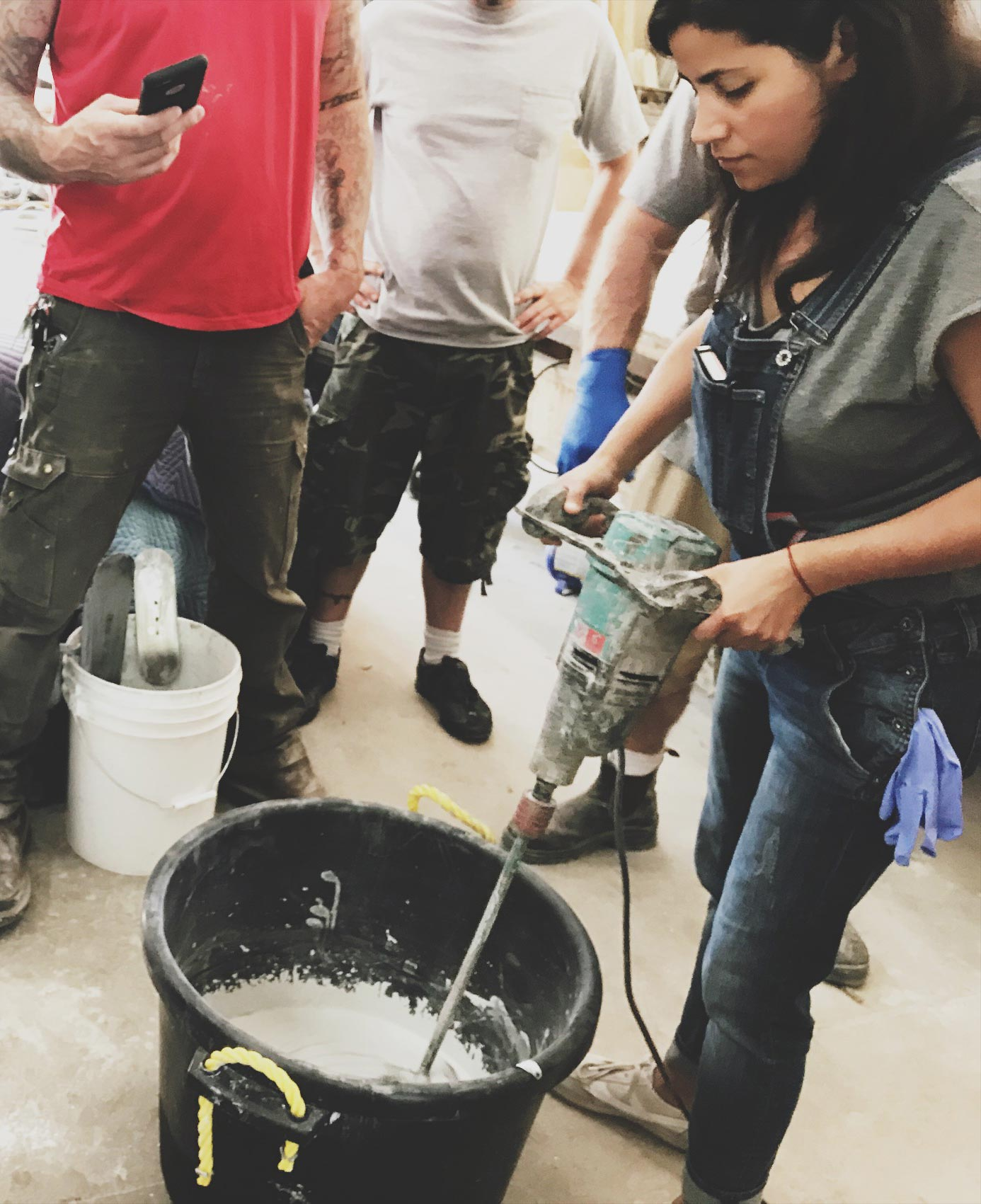 Concrete workshop attendee learning how to properly mix GFRC for concrete sinks and countertops