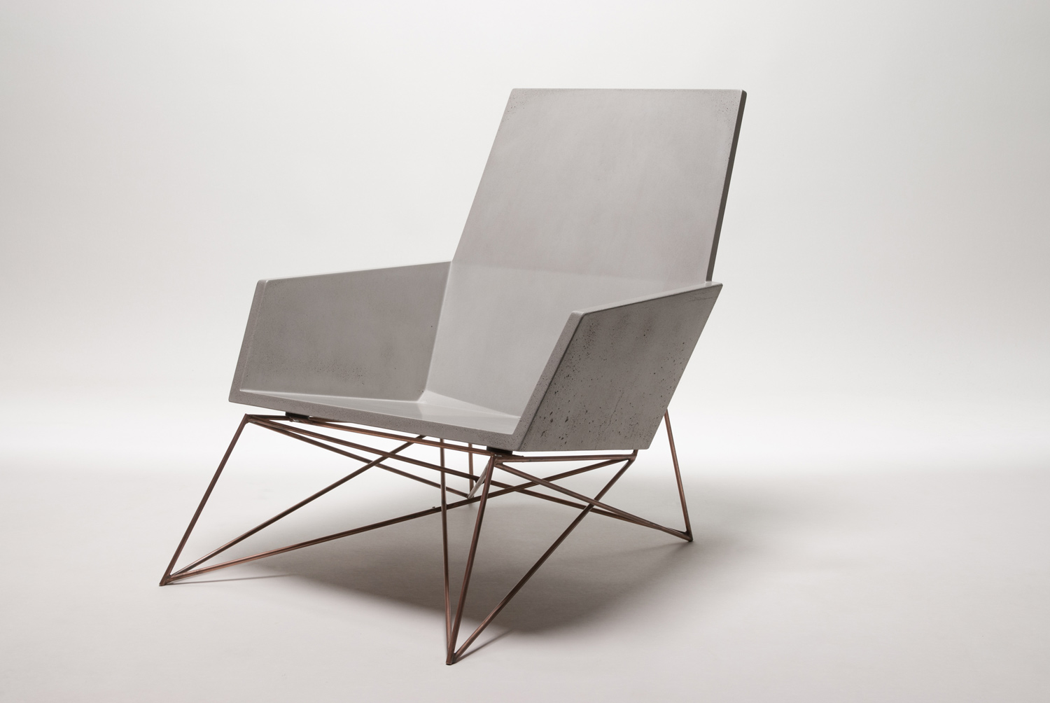A modern concrete + copper concrete chair for indoor and outdoor applications