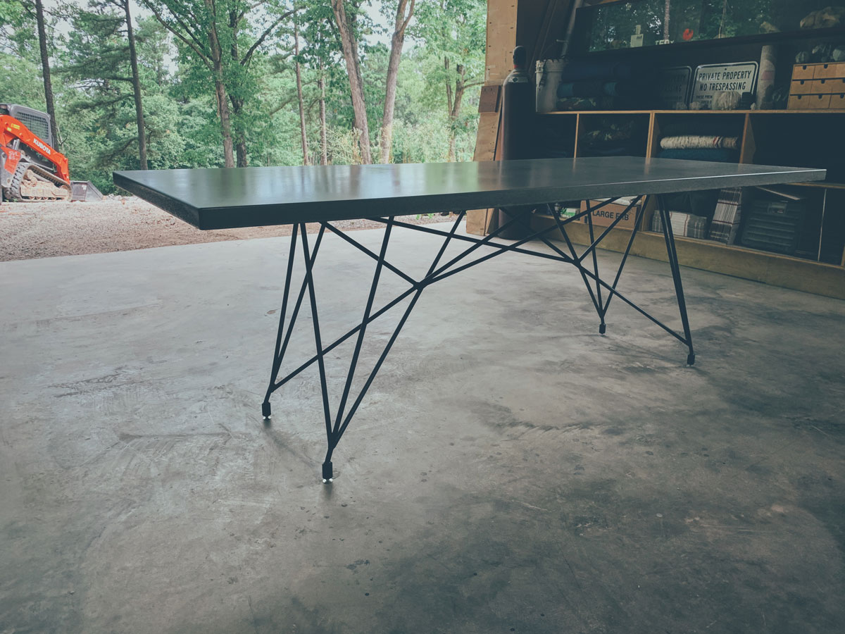 A custom concrete and steel outdoor dining table for a bakehouse in Missouri