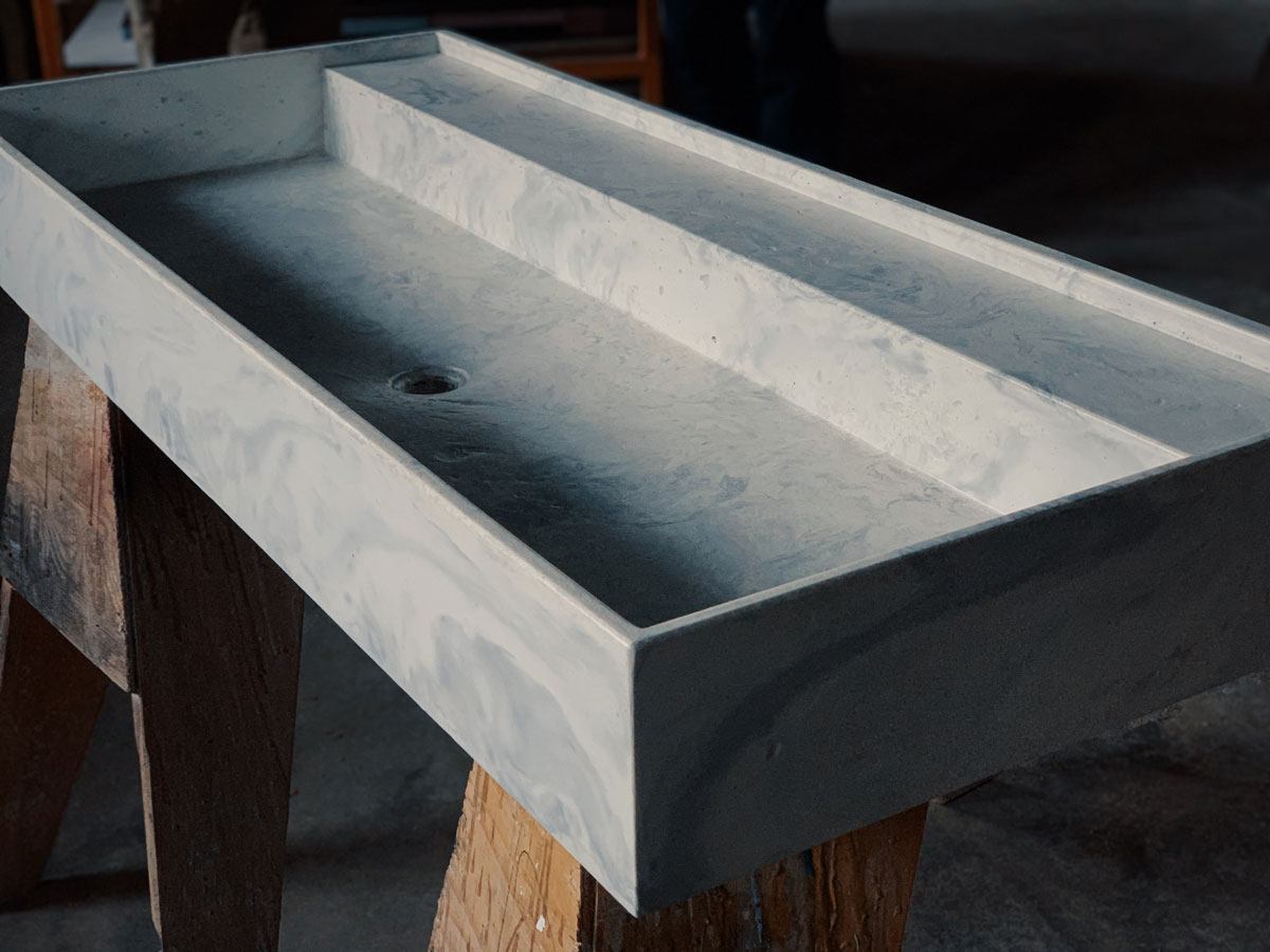 a modern concrete sink made by workshop attendees of the Dusty-Crete class