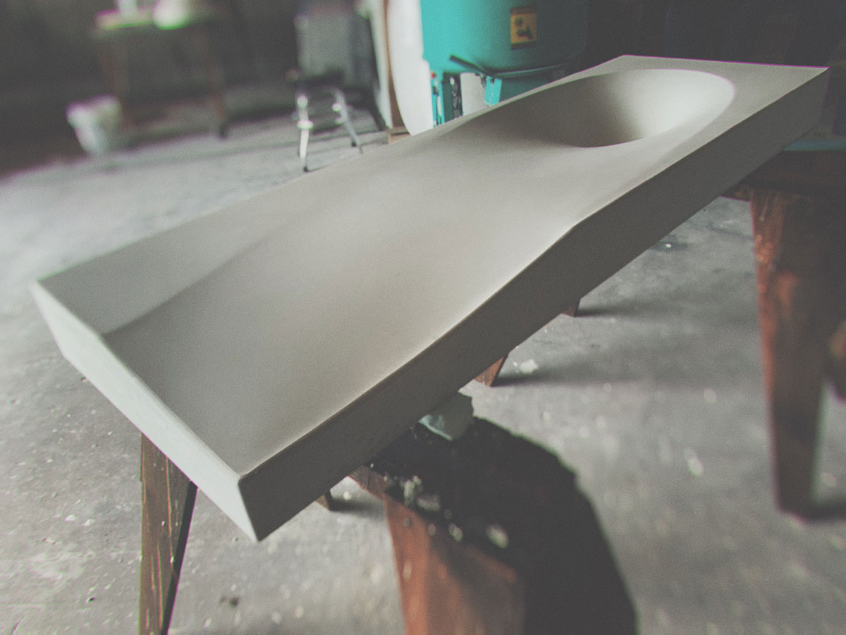 A fabric formed sink designed by brandon gore and made by the concrete design school workshop