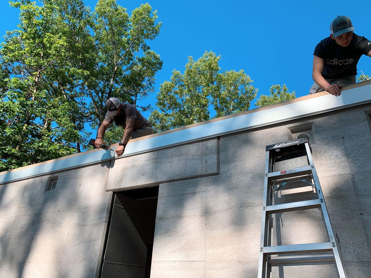installing the custom metal fascia on the modern cabin in eureka springs, ar