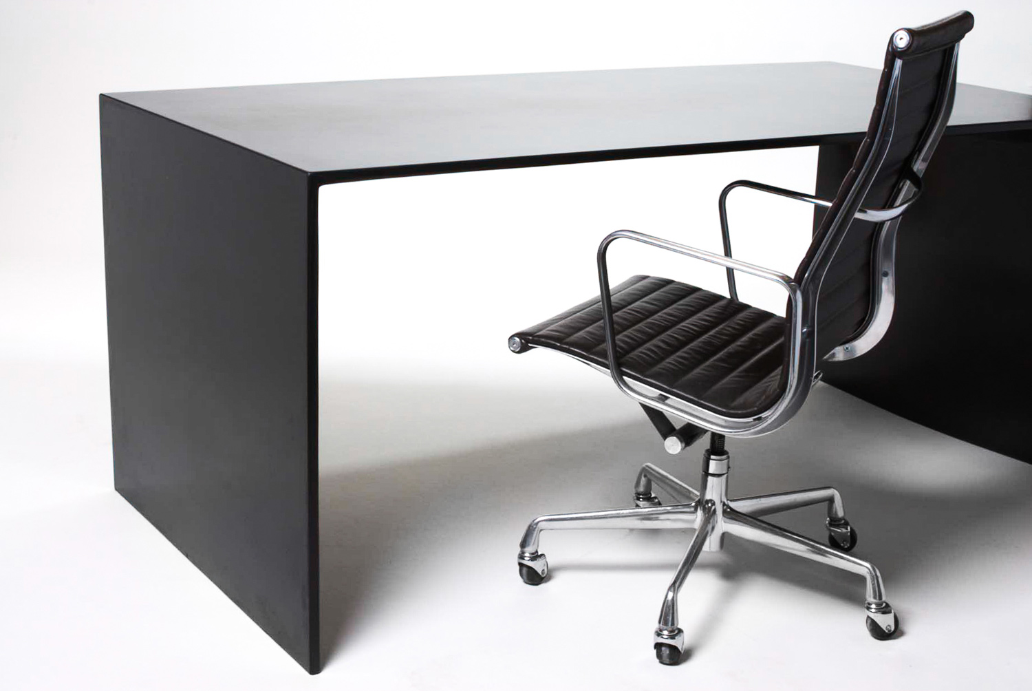 A custom black concrete desk for a modern home designed by Hufft Architects in Kansas City