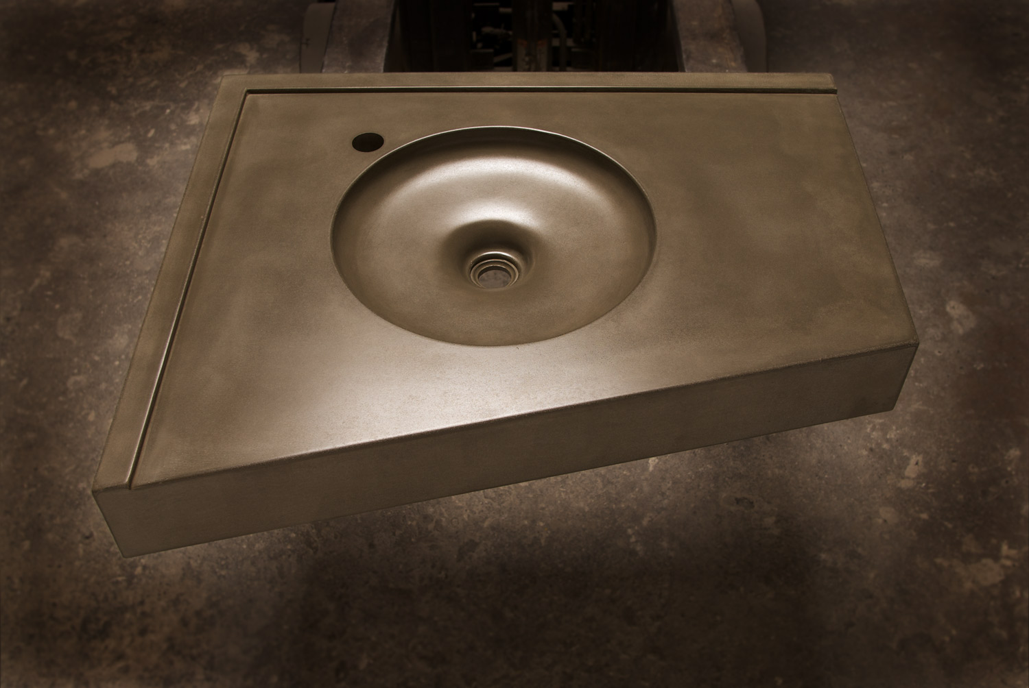 A simple round concrete sink for a floating corner installation, with an integral backsplash