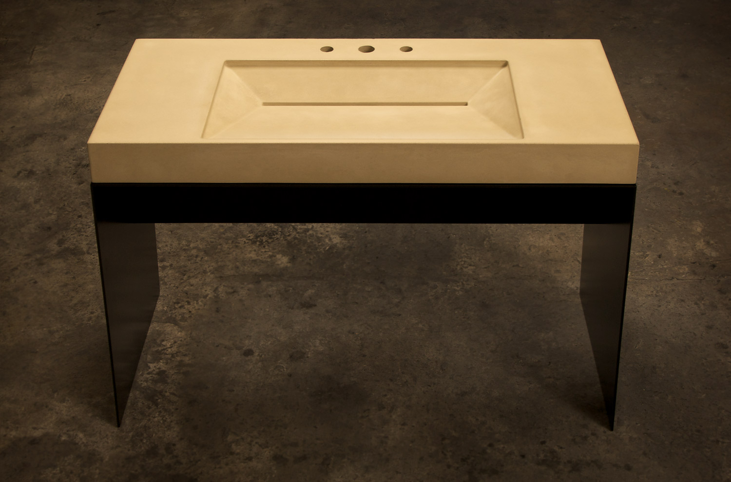 ADA Concrete Ramp Sink in beige concrete on a custom blackened steel sink base