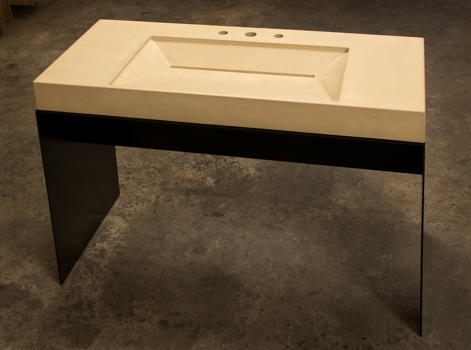 Concrete Ramp Sink in off-white on a blackened steel sink base for an ADA residence in San Francisco, CA