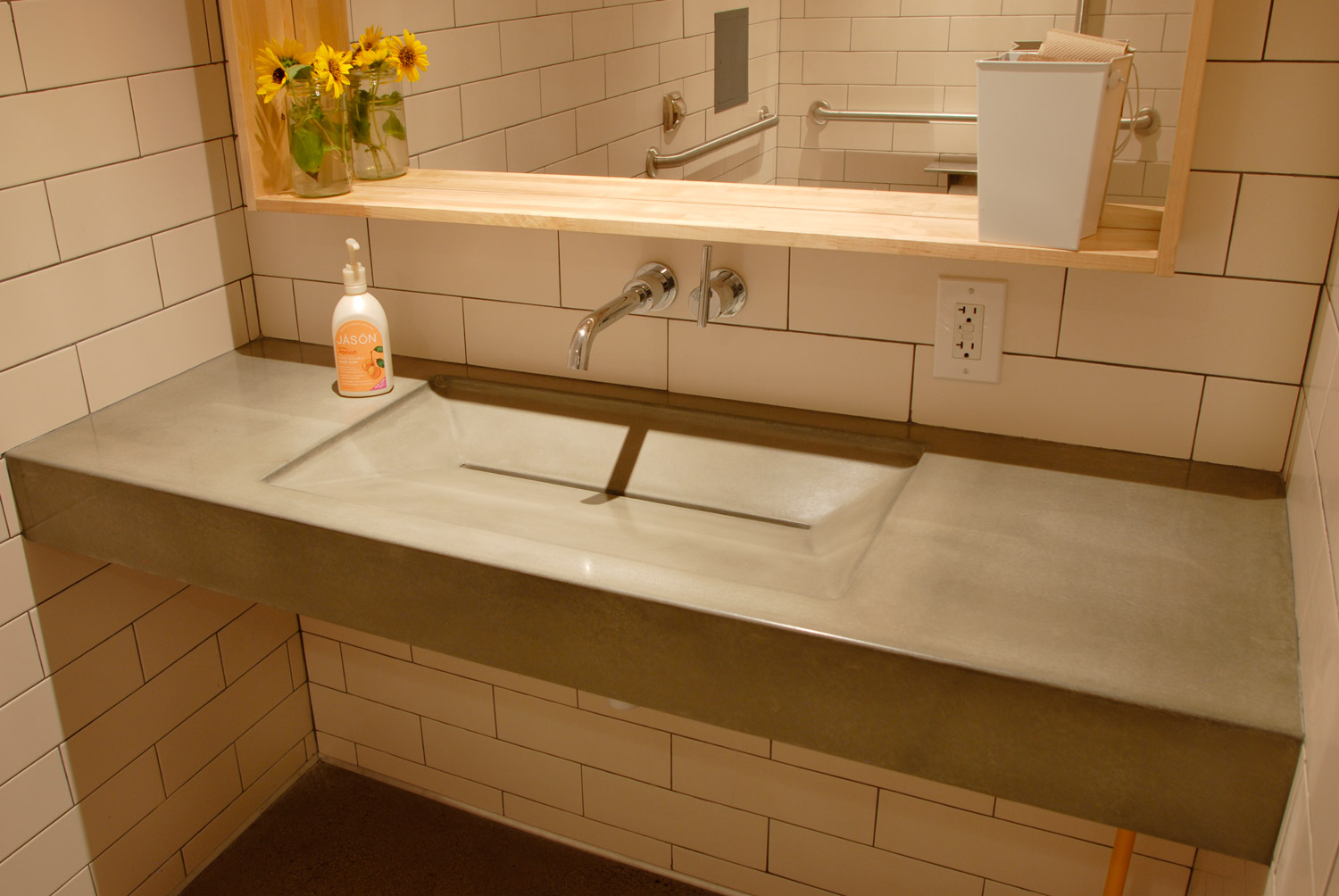 Floating natural grey concrete ramp sink in a coffee shop in Tempe, AZ.