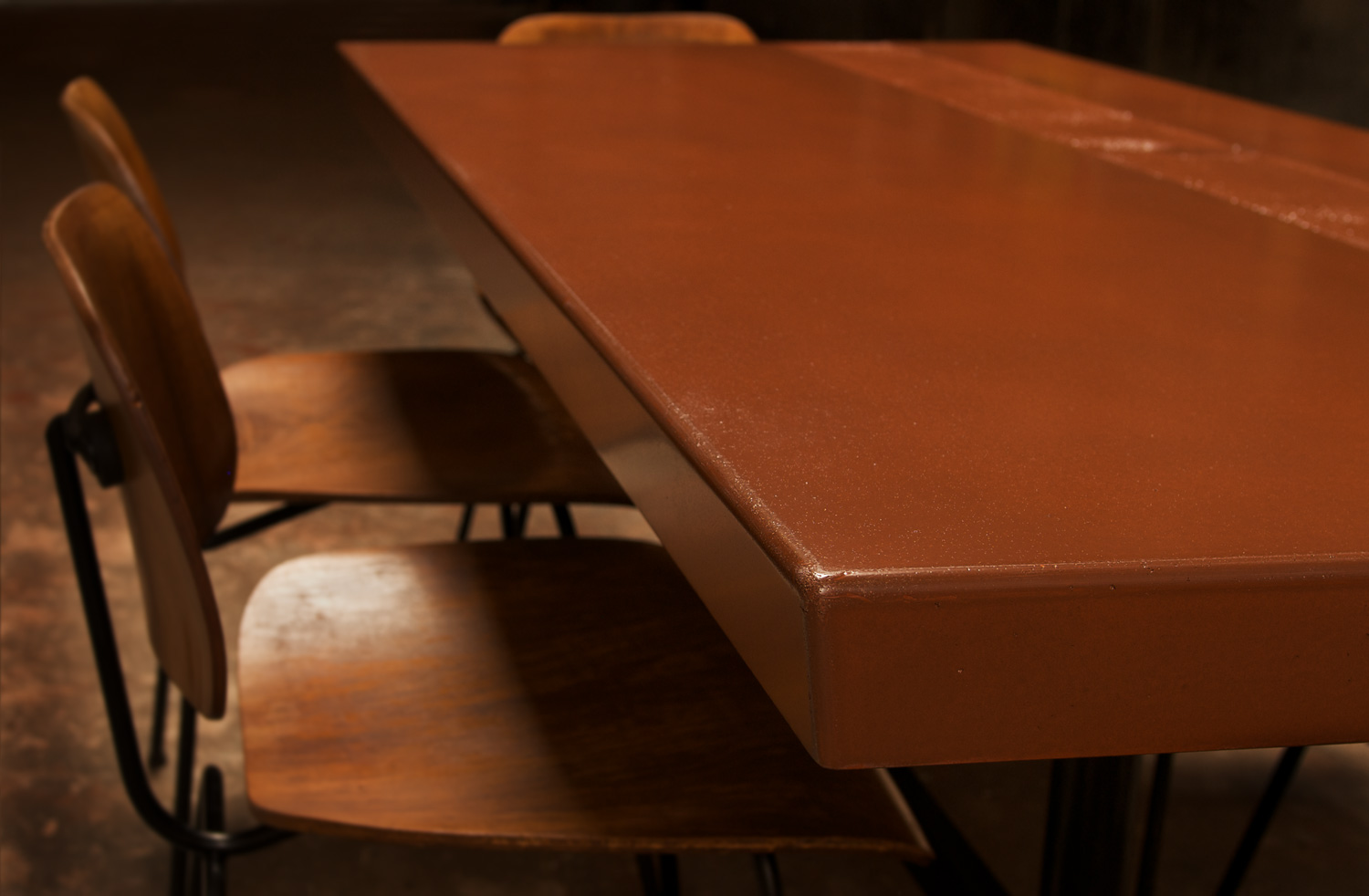 Red concrete dining table edge detail