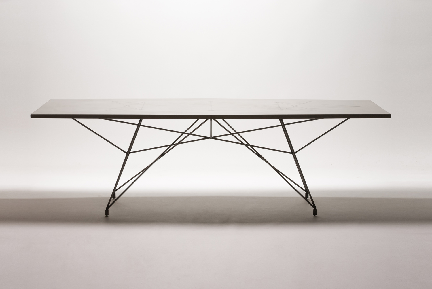 Minimal and modern concrete and steel rod dining table