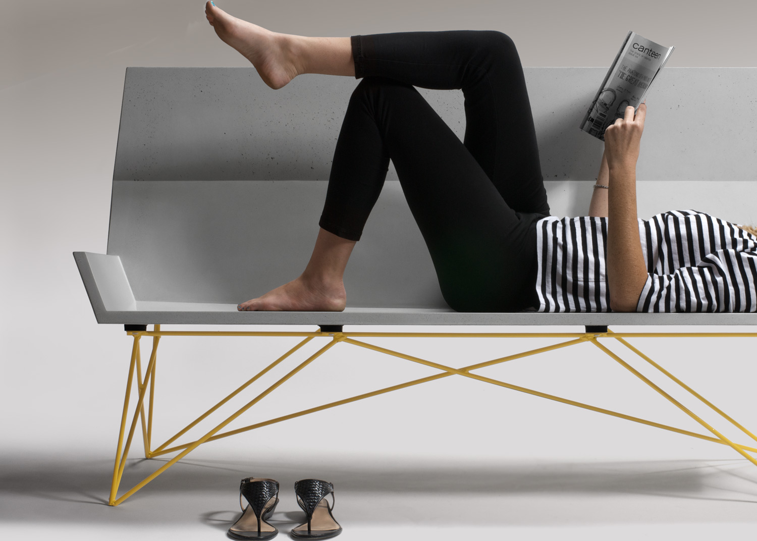 Relaxing on a custom concrete + steel mid century modern bench