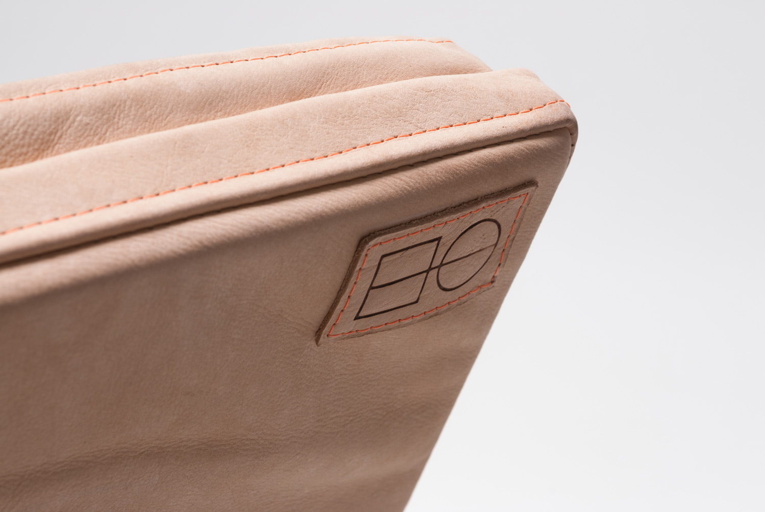 The Hard Goods logo branded into a leather seat cushion