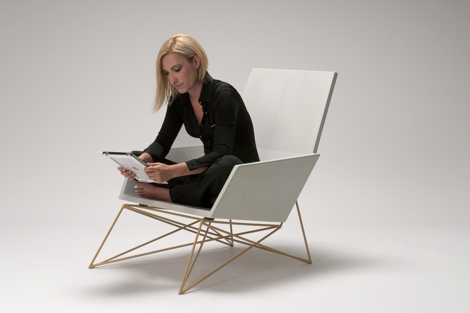 The comfortable concrete Modern Muskoka Chair shown in white GFRC with a yellow steel base