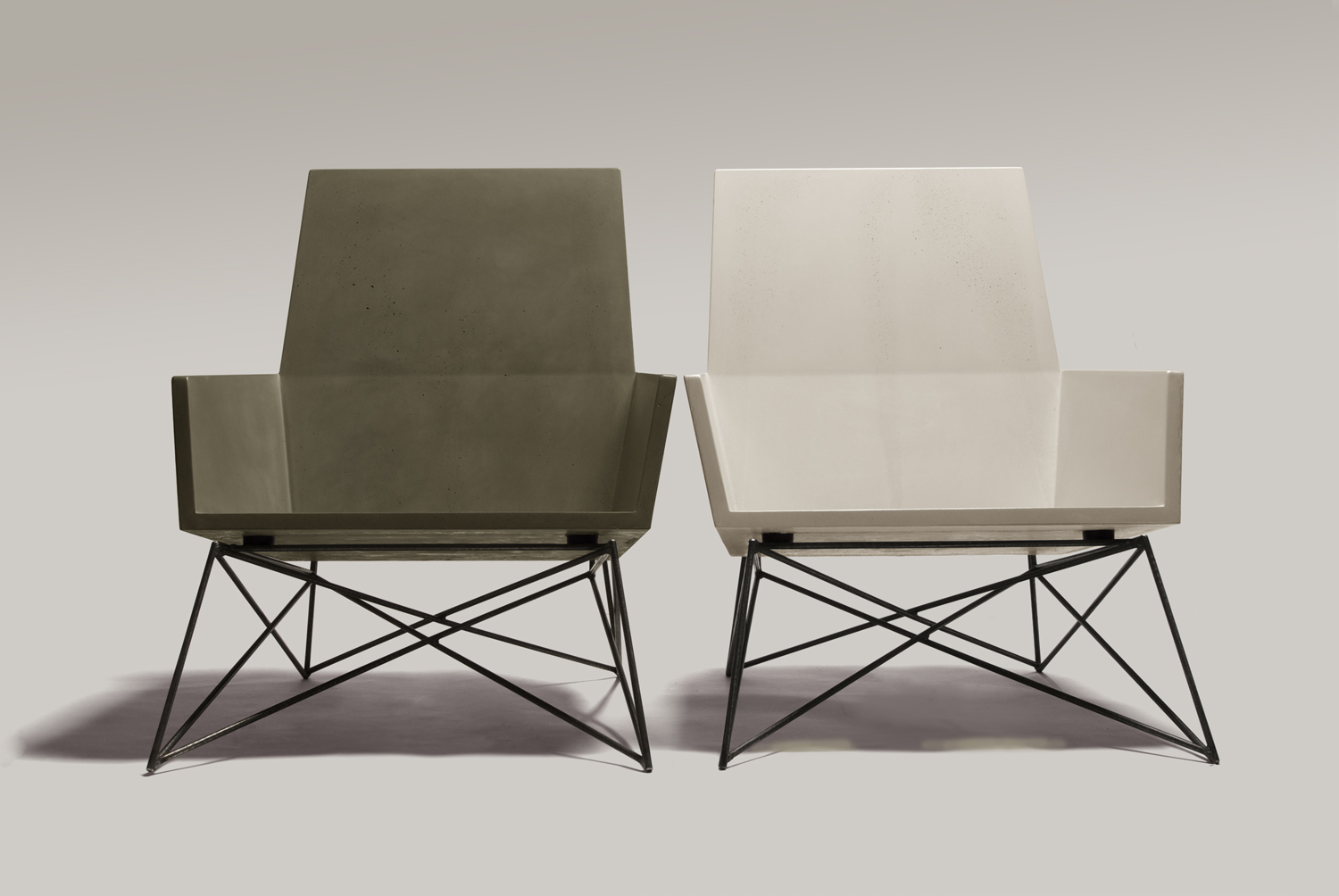 2 modern outdoor concrete chairs, one in natural grey GFRC and the other in white GFRC. These chairs won the award for 'Best Furniture Design' at the Dwell on Design Tradeshow in Los Angeles, CA in 2012