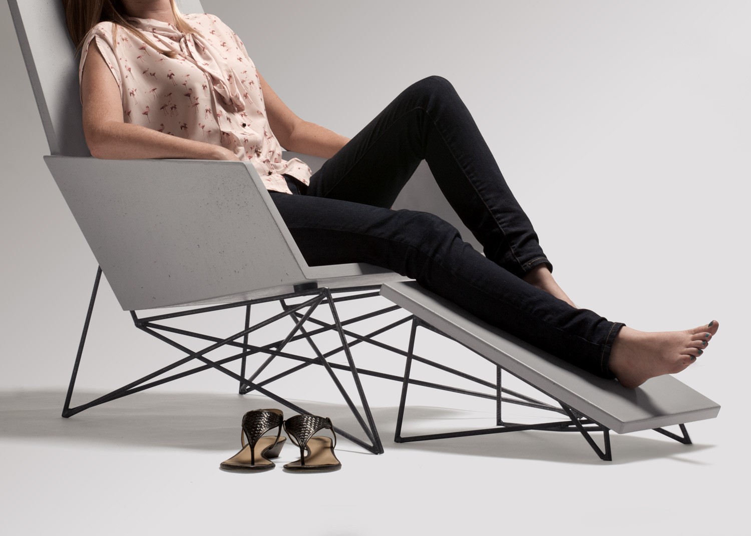 The concrete Modern Muskoka Outdoor Chair is ergonomically comfortable