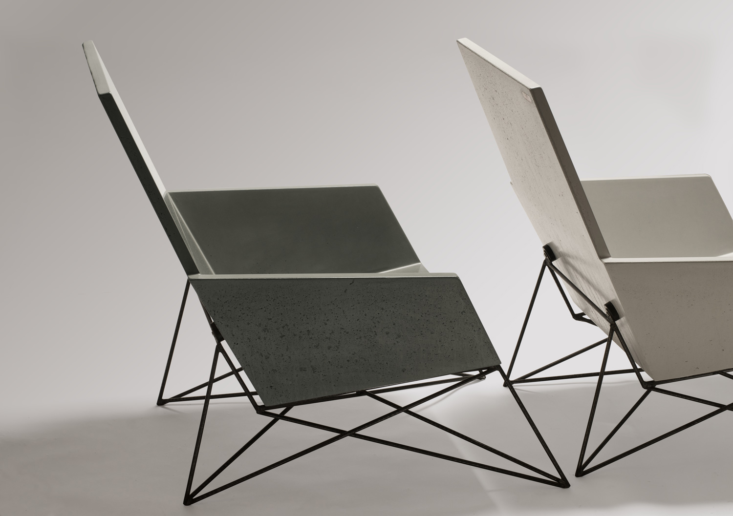 2 Modern Muskoka Outdoor Chairs, one in natural grey concrete and the other in white