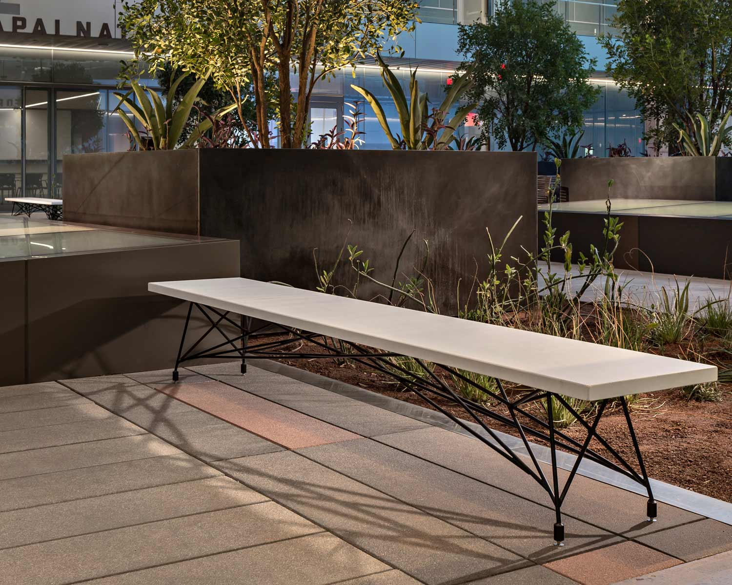 A custom white concrete + steel modern bench for a commercial project in Phoenix, AZ