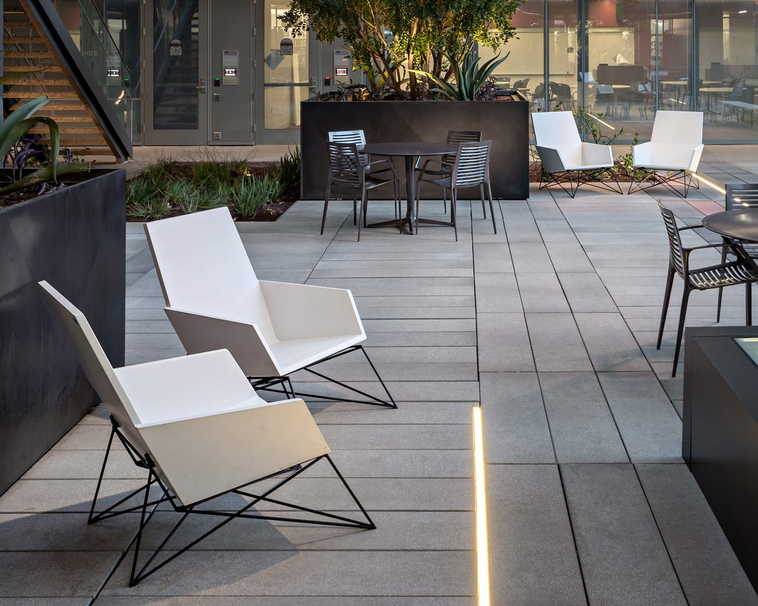 Concrete + Steel Modern Muskoka Outdoor Chairs and faceted black GFRC concrete wall cladding panels