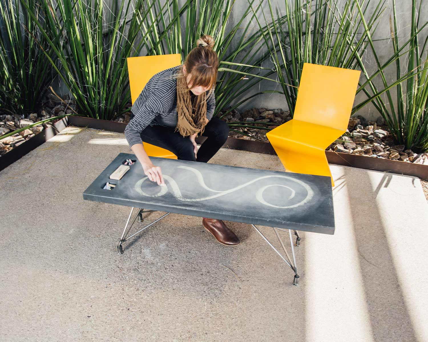 Chalkboard coffee table that you can draw on, made of concrete and custom steel base