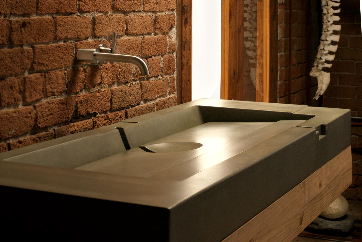 Custom concrete sink in natural grey concrete made of GFRC for a modern loft in Scottsdale, AZ