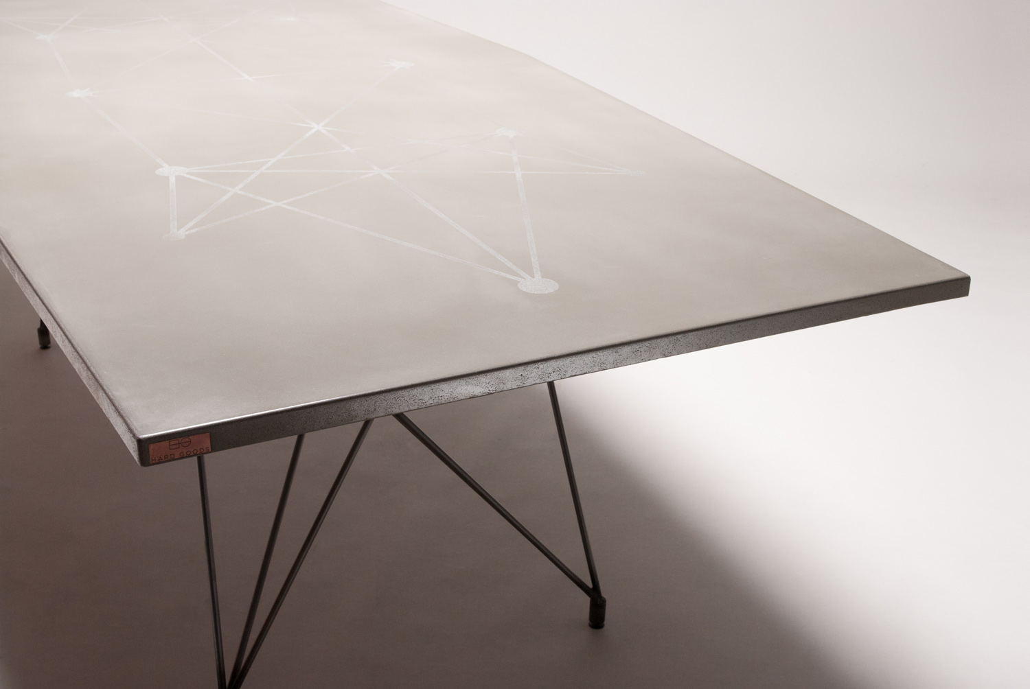 sandblasted pattern in a custom concrete and steel GFRC table