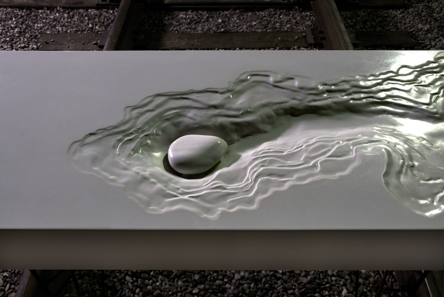 The Concrete Erosion Sink is an original design by Brandon Gore. The sink is a layered, topographic design made with white GFRC