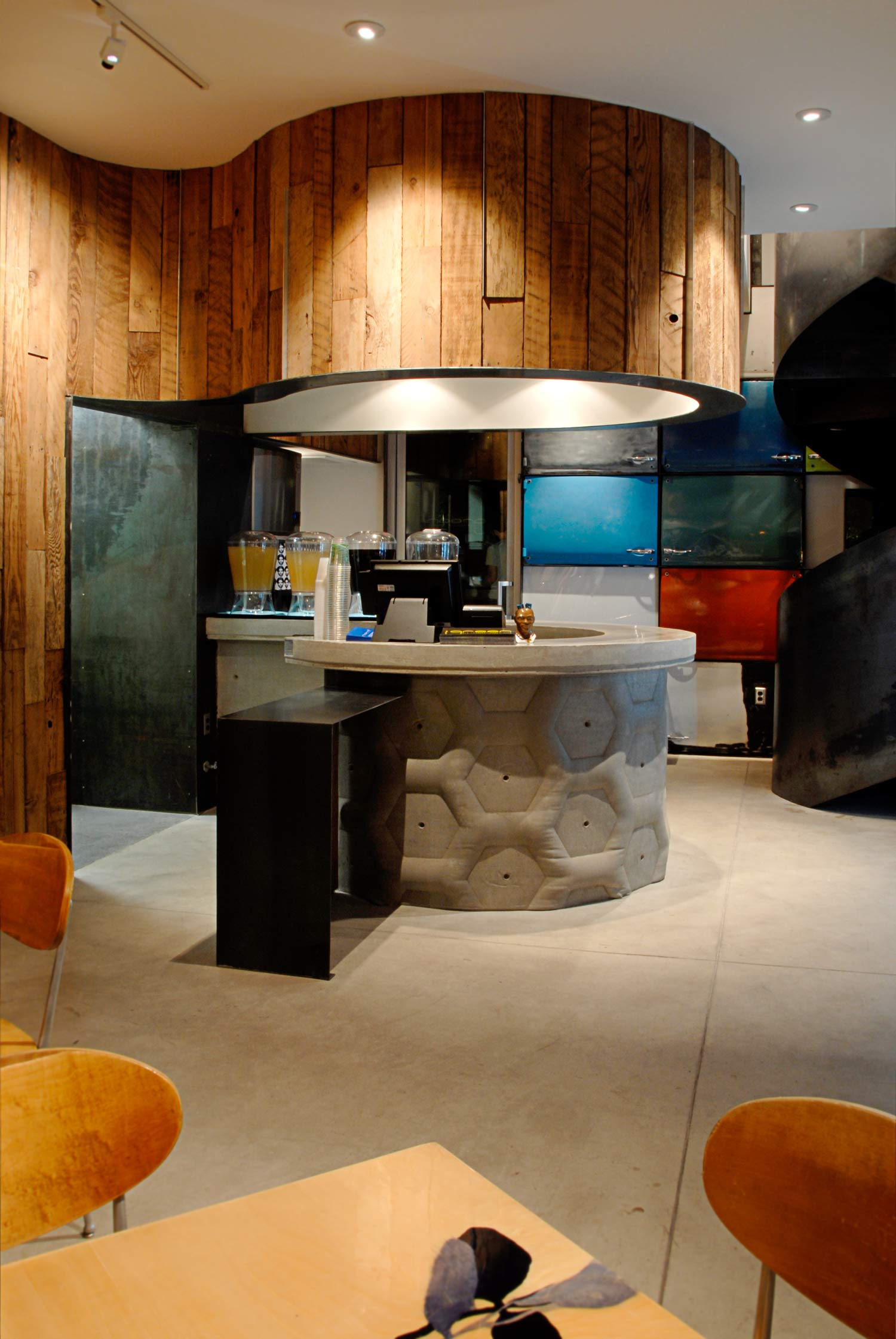 Fabric formed concrete wall with countertop in a modern restaurant