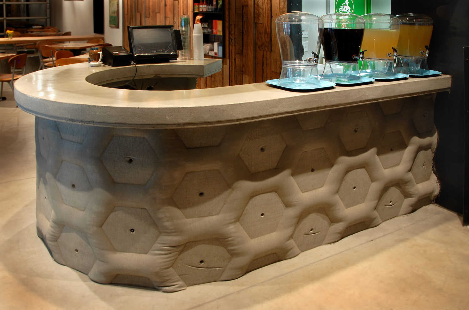 curved concrete countertop and cast in place fabric formed wall for a restaurant