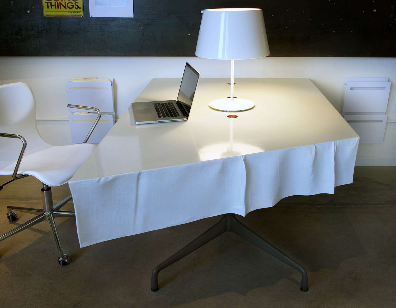 Fabric formed free flowing white concrete table