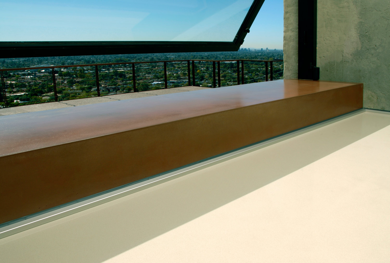 A red concrete countertop and window sill for a high end private residence on the side of camelback mountain in scottsdale, AZ