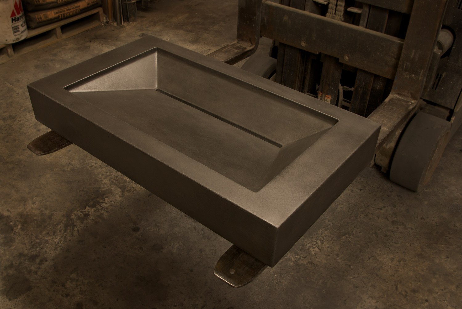 ADA compliant concrete ramp sink, shown here in charcoal colored gfrc