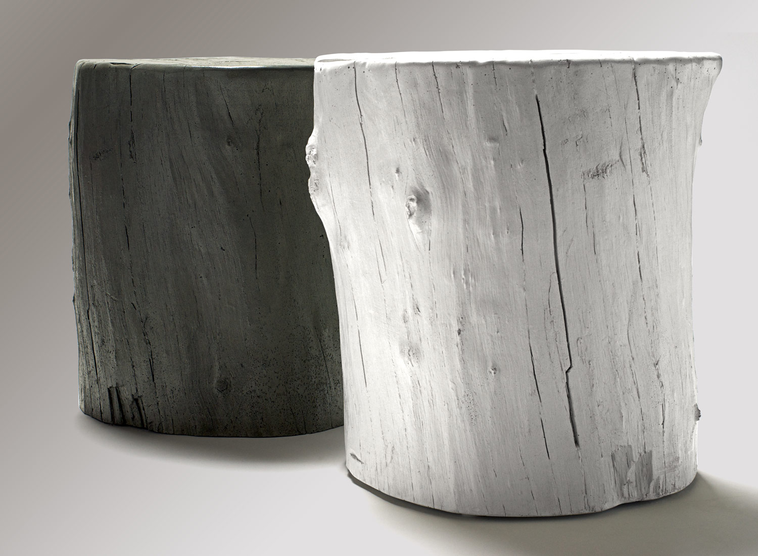 2 concrete knotty stools, which are concrete stools or tables made from forms taken from real trees