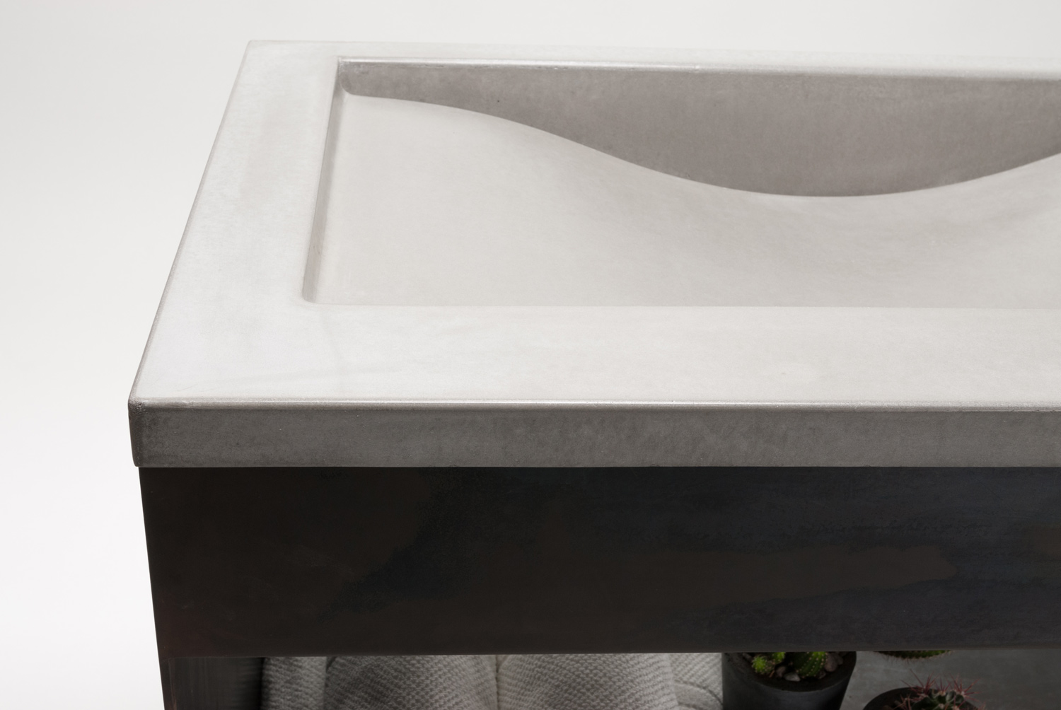 Concrete wave sink on a natural steel sink base
