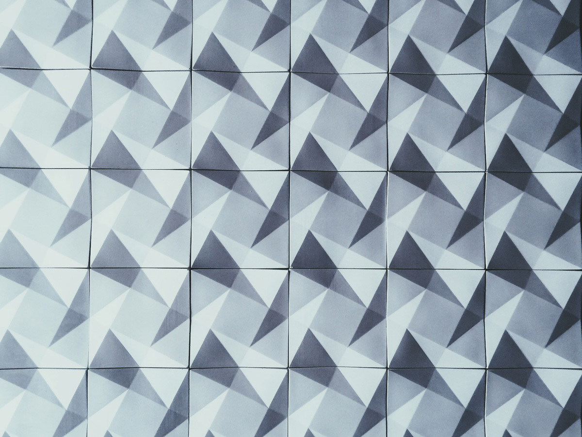 geometric modern concrete wall tile, shown in white gfrc, handmade in the USA