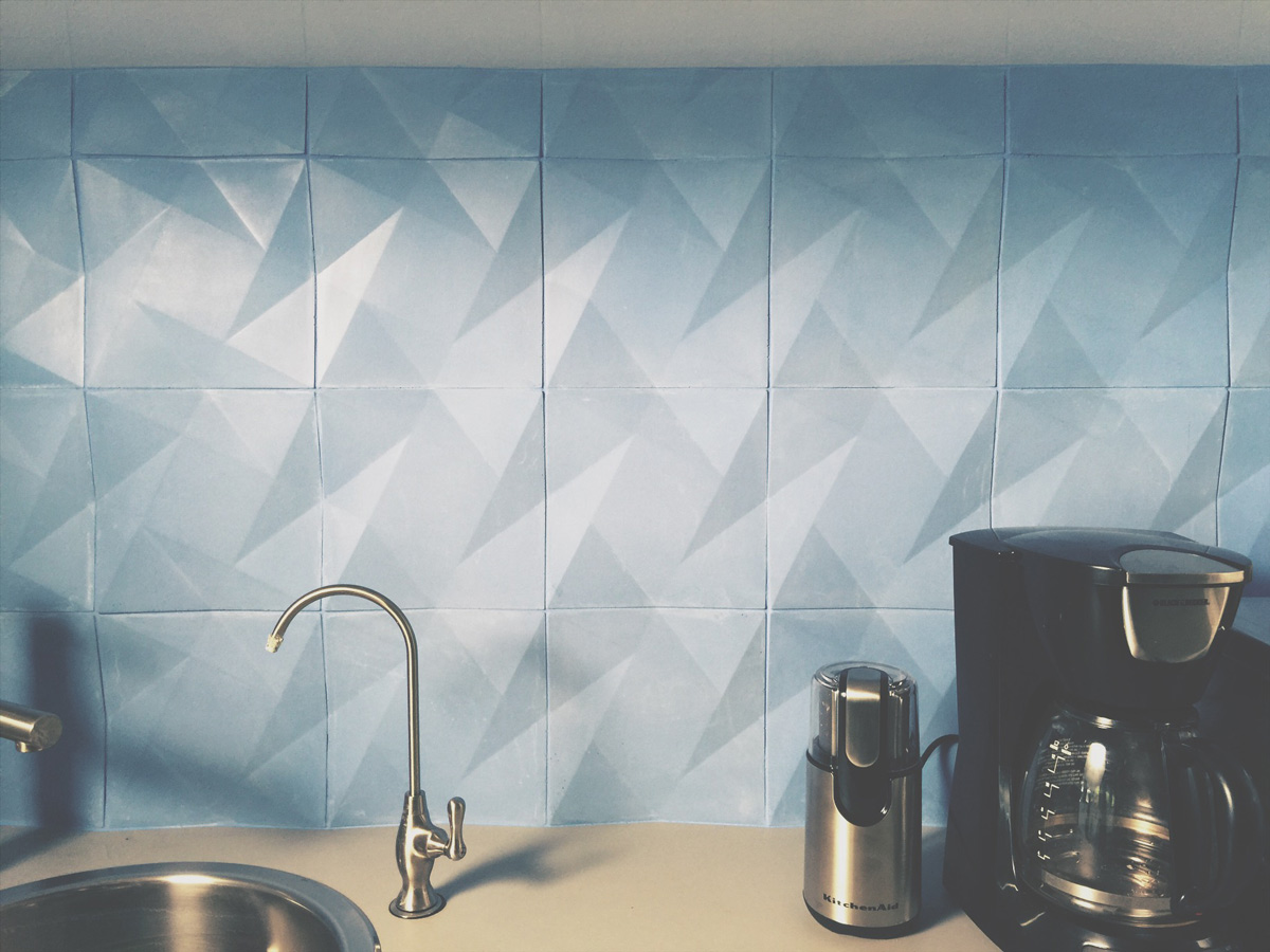 modern concrete wall tile, geometric facets, 3d pattern