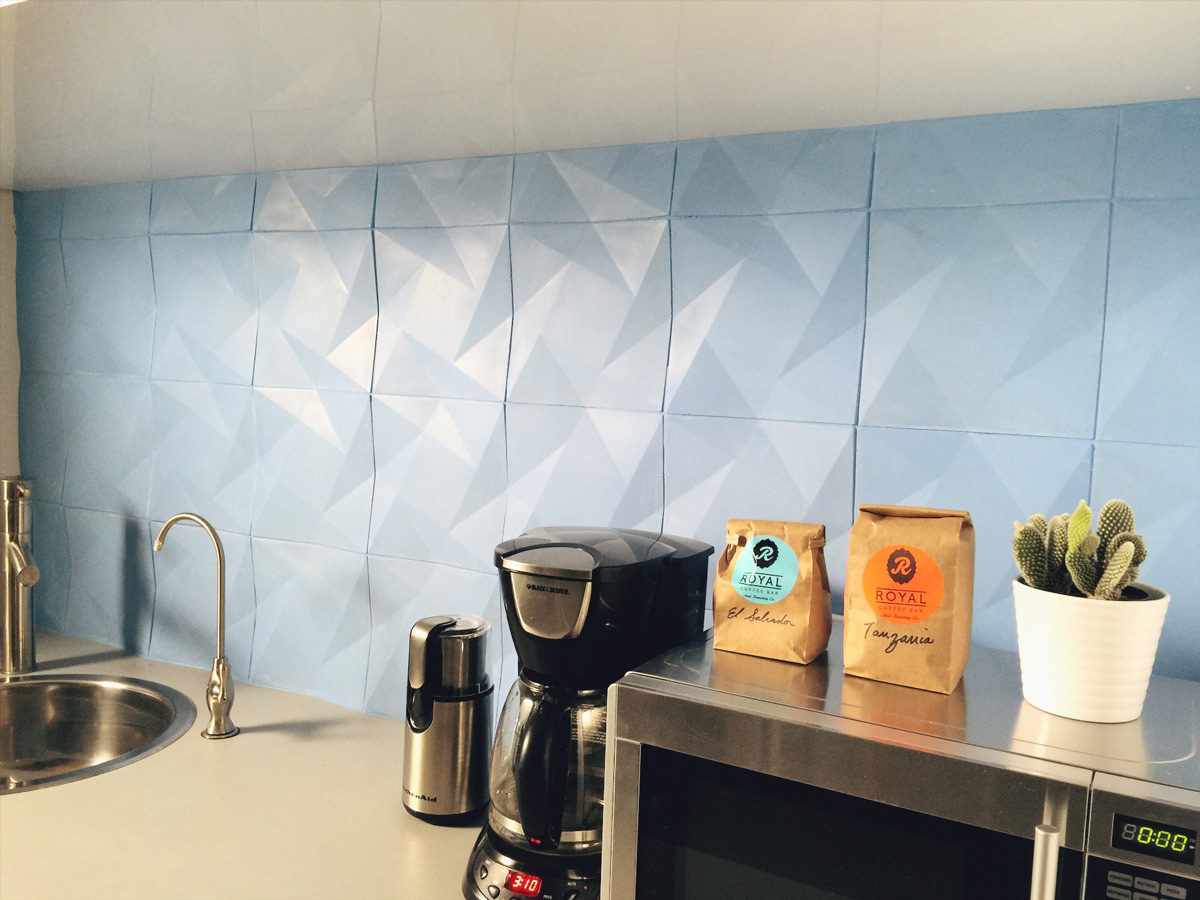 geometric concrete wall tile, shown here in custom blue gfrc