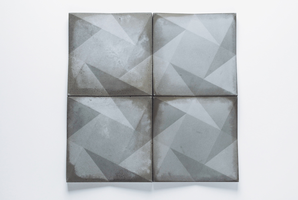 faceted concrete wall tile shown in natural grey gfrc