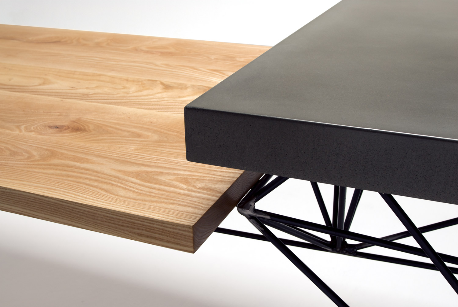 detail of a concrete, wood, and steel contemporary table