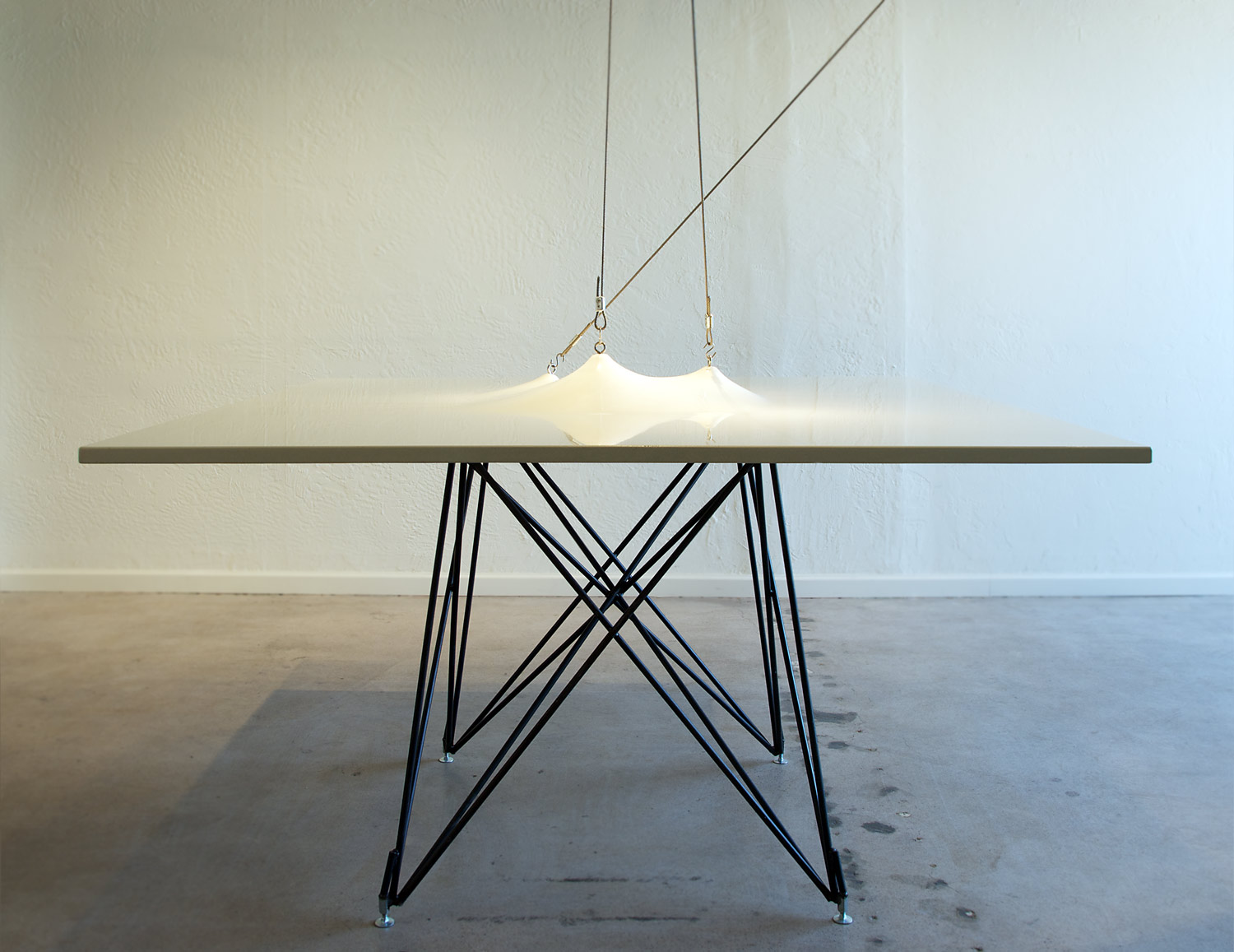 Ultra modern white GFRC concrete conference table with a custom steel base