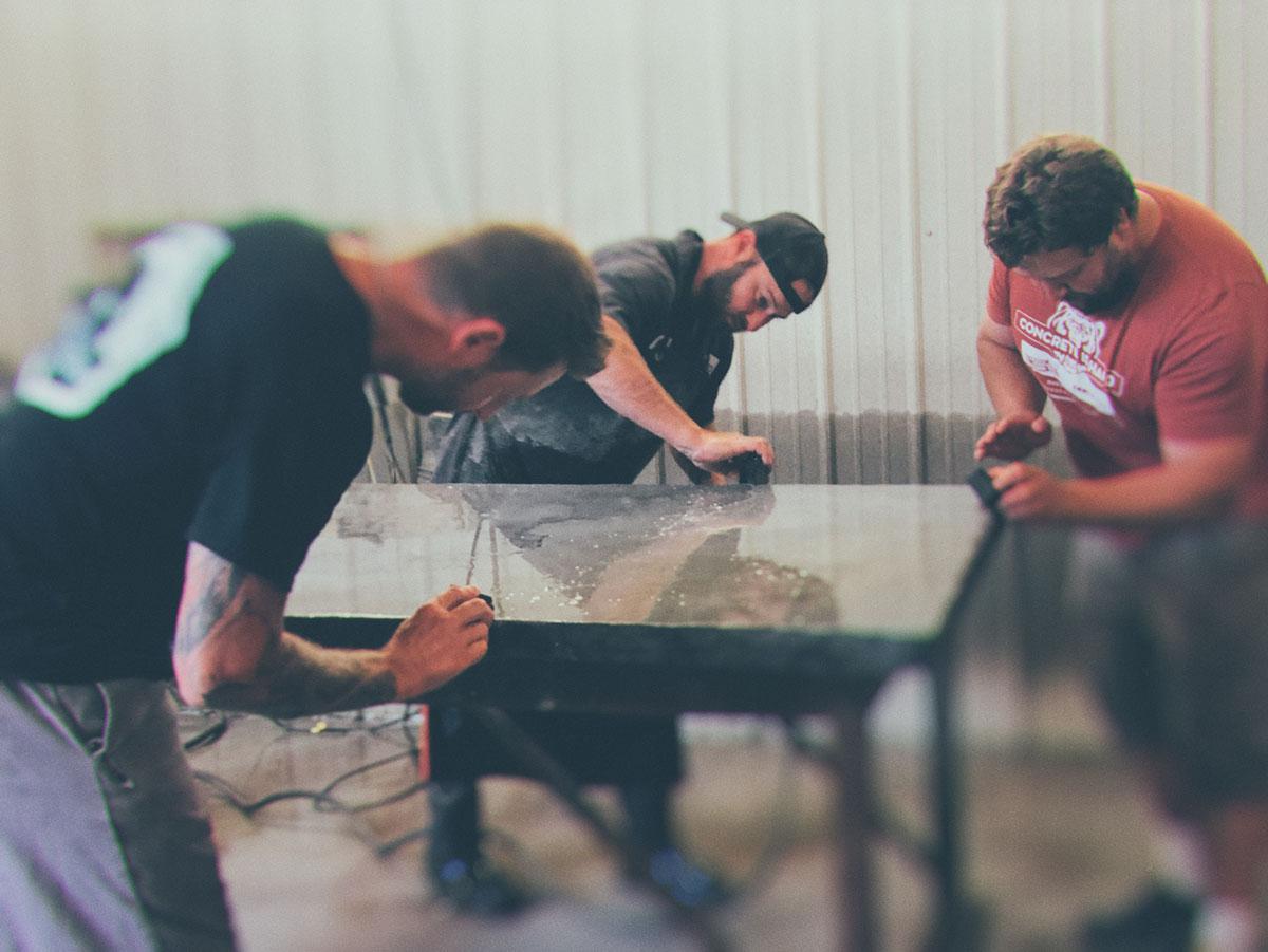 Concrete Design School workshop attendees making a concrete table