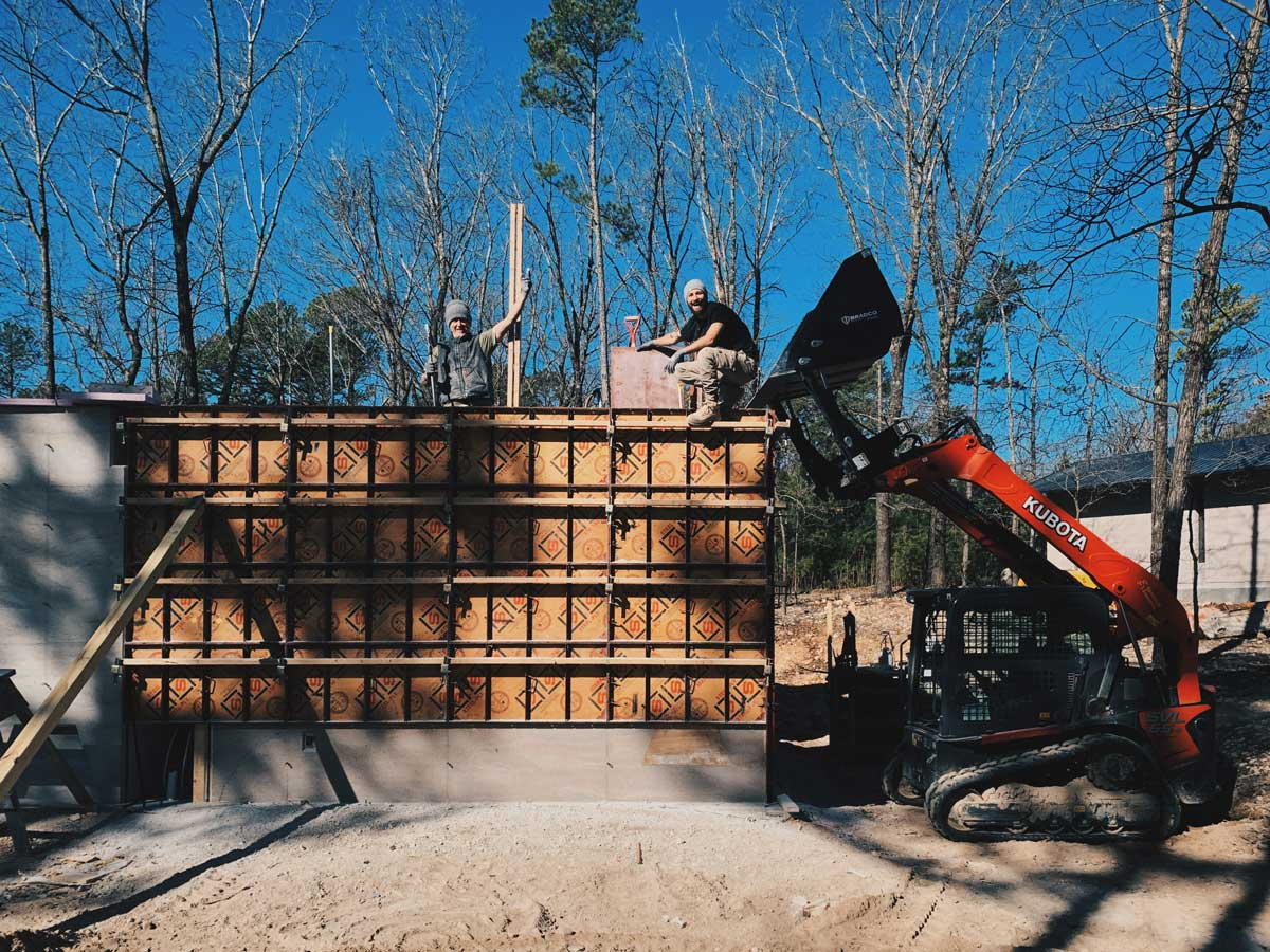 The EarthFrom crew finishing a rammed earth wall on a sustainable modern house in NW Arkansas.