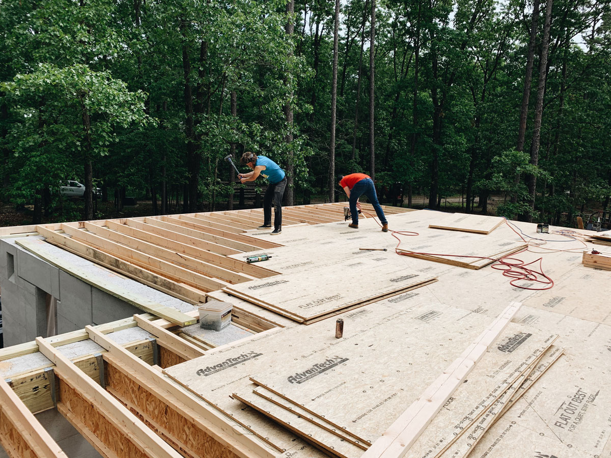 framing the roof on a modern cabin in nw arkansas