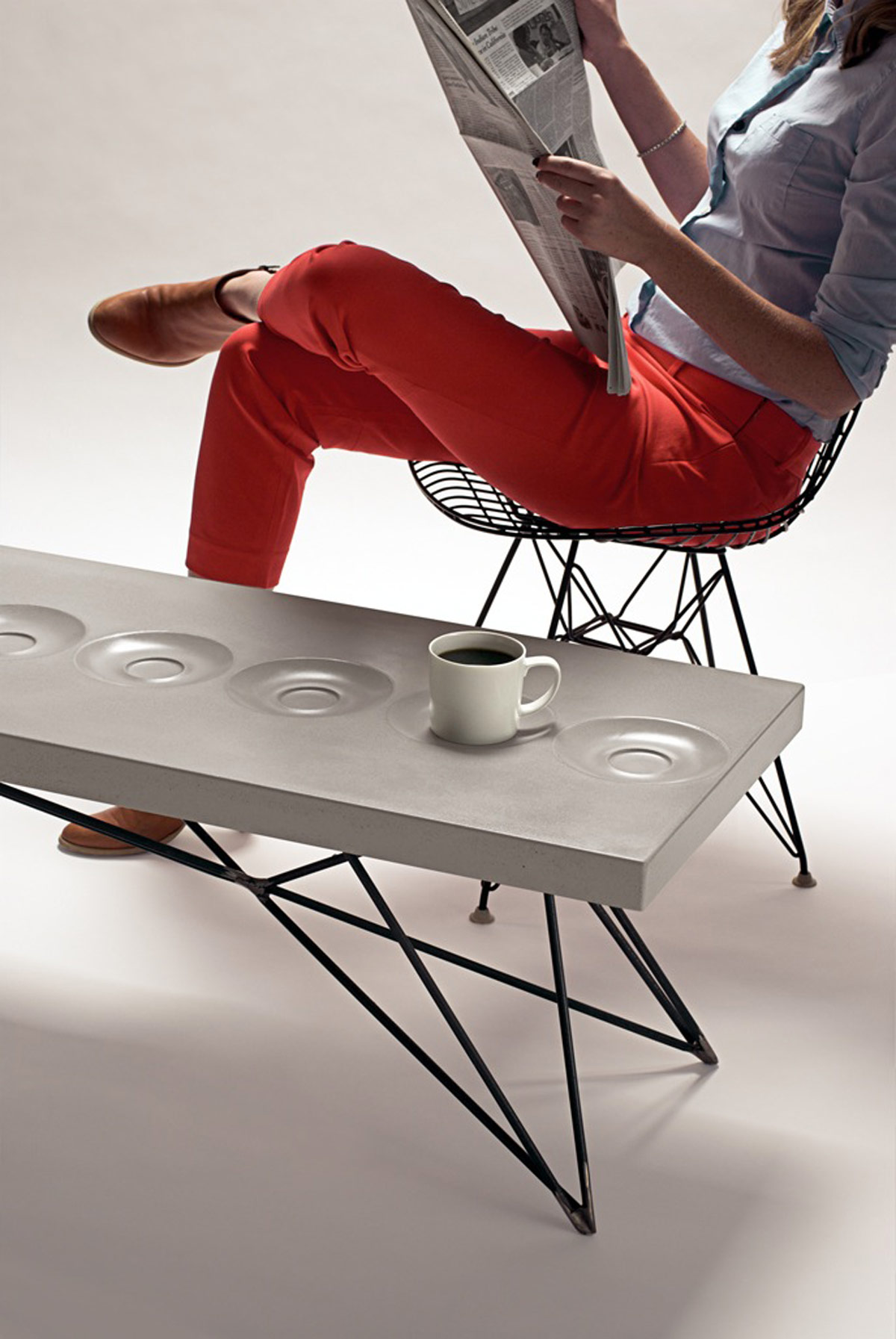 The ORSON Concrete Coffee table has built in saucers for your coffee mug