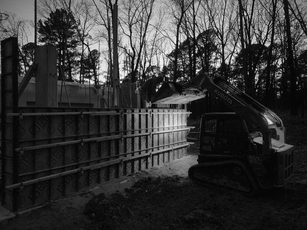 The construction process on a rammed earth wall in NW Arkansas