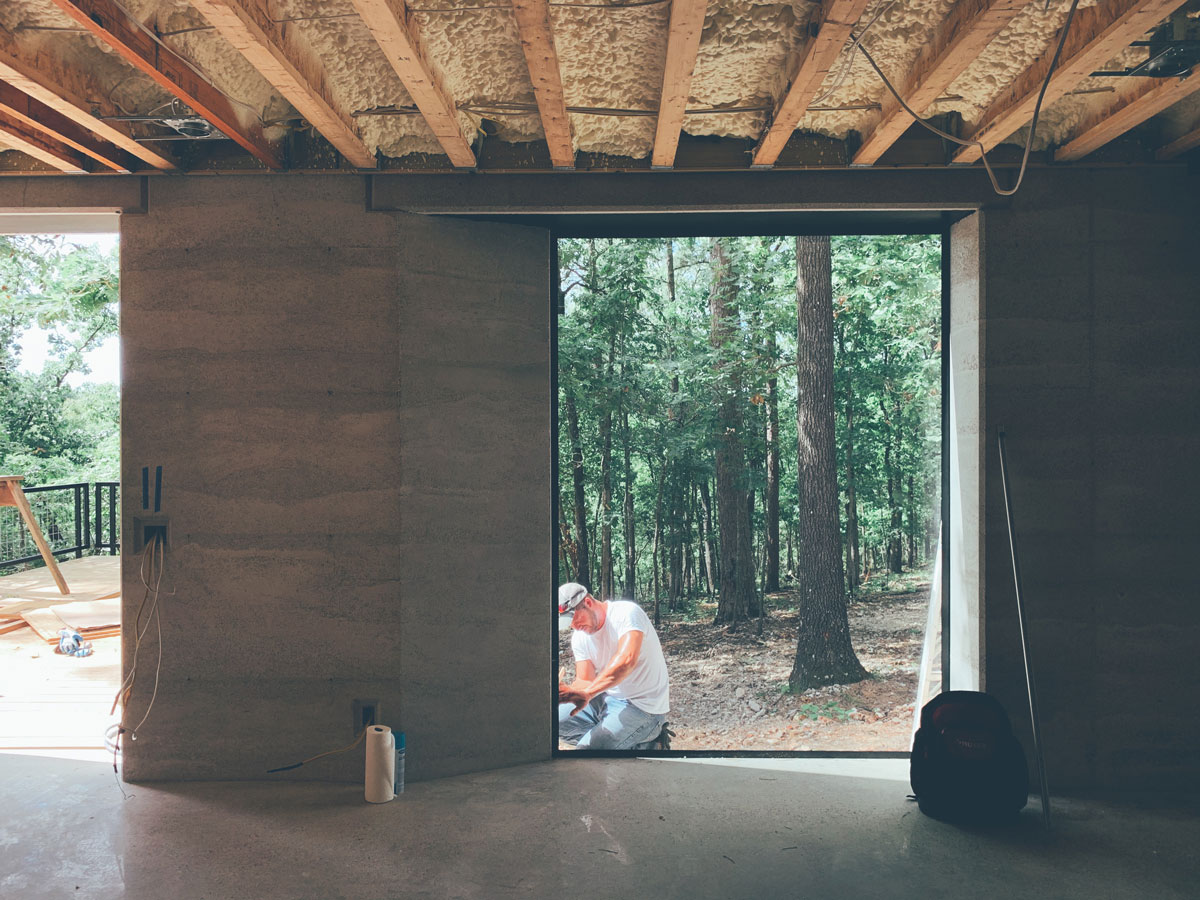 The view from inside the modern cabin in the woods into the Ozark mountain forest