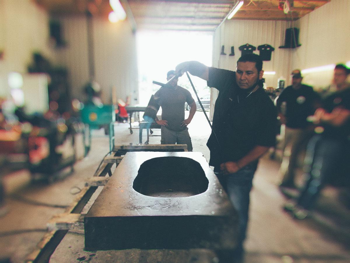 A class attendee sealing a concrete sink using Kodiak Pro QUANTUM sealer